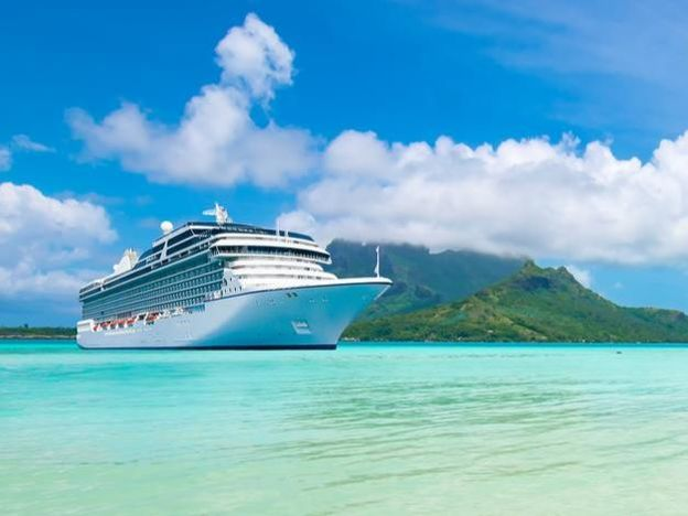 Cruise ship docked on beach in Bora Bora